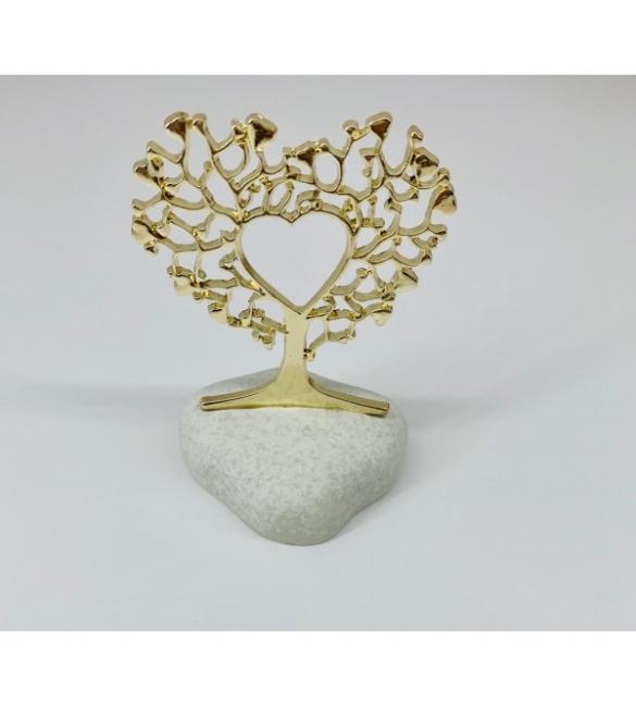 Χρυσό δέντρο ζωής σε βότσαλο.